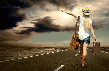 stock-photo-young-woman-with-guitar-on-the-road-and-her-vintage-baggage-110371820